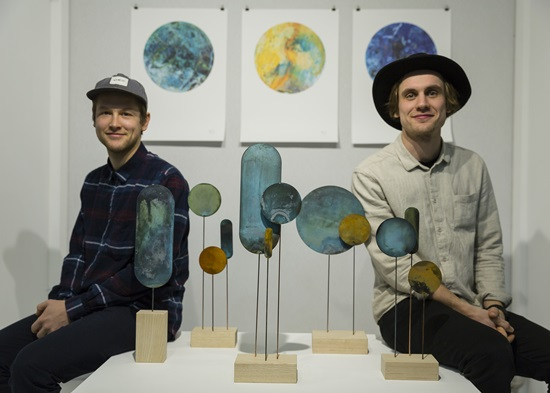 The designers of Studio Kneip with their creations