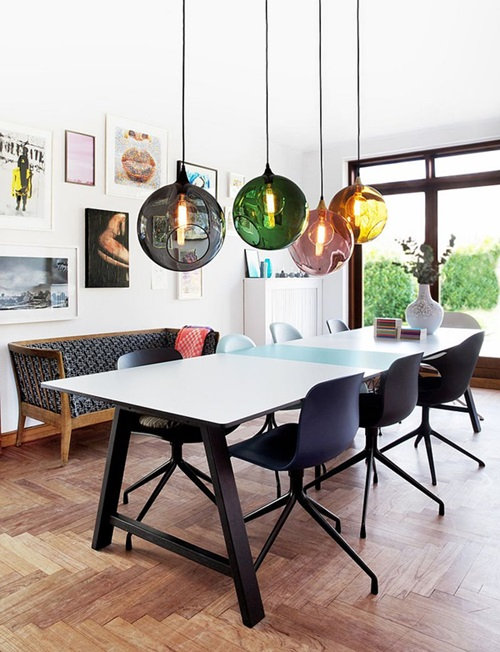 Colorful-orbs-above-the-dining-table-breathe-life-into-the-curated-contemporary-dining-room