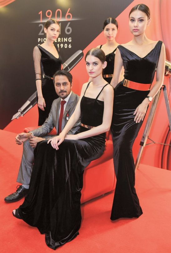 Film director & actor, Bront Palarae with models