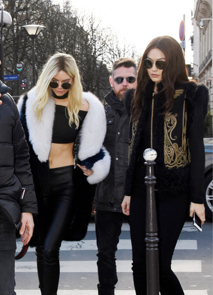 February 3rd, 2016 - Paris Blonde Kendall Jenner swaps hair colour with brunette Gigi Hadid as they switch up their style at the Balmain show for 2016 Paris Fashion Week. ****** BYLINE MUST READ : © Spread Pictures ****** ****** No Web Usage before agreement ****** ******Please hide the children's faces prior to the publication****** ****** Stricly No Mobile Phone Application or Apps use without our Prior Agreement ****** Enquiries at photo@spreadpictures.com